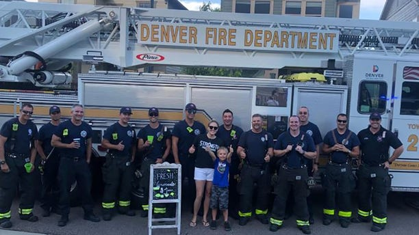 Brady Campbell and his mom Amanda with the Denver Fire Department.