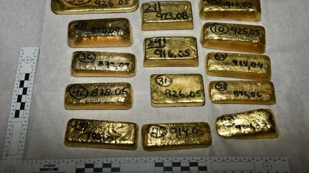 Five million dollars' worth of gold bars, partially pictured here, have been seized at London's Heathrow Airport by law enforcement officials investigating a South American drug cartel.