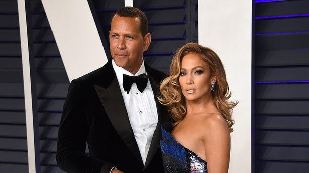 Alex Rodriguez, left, and Jennifer Lopez arrive at the Vanity Fair Oscar Party on Sunday, Feb. 24, 2019, in Beverly Hills, Calif. (Photo by Evan Agostini/Invision/AP)