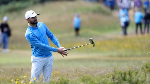Kyle Stanley of the United States plays out of the rough on the 10th hole during the third round of the British Open Golf Championships at Royal Portrush in Northern Ireland, Saturday. (AP Photo/Peter Morrison)
