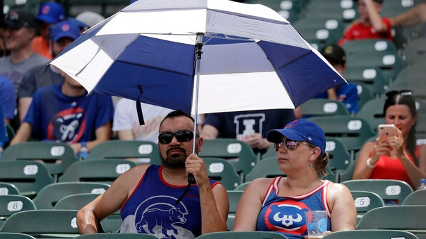 Chicago Cubs fans sit as they wait for a baseball game between the San Diego Padres and the Chicago Cubs in Chicago, Saturday, July 20, 2019.
