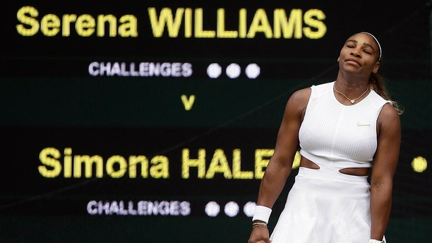 United States' Serena Williams reacts after losing a point to Romania's Simona Halep during the women's singles final match on day twelve of the Wimbledon Tennis Championships in London, Saturday, July 13, 2019. (AP Photo/Tim Ireland)