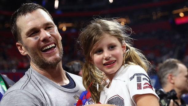 ATLANTA, GEORGIA - FEBRUARY 03: Tom Brady #12 of the New England Patriots celebrates with Vivian Lake Brady after his 13-3 win against Los Angeles Rams during Super Bowl LIII at Mercedes-Benz Stadium on February 03, 2019 in Atlanta, Georgia. (Photo by Maddie Meyer/Getty Images)