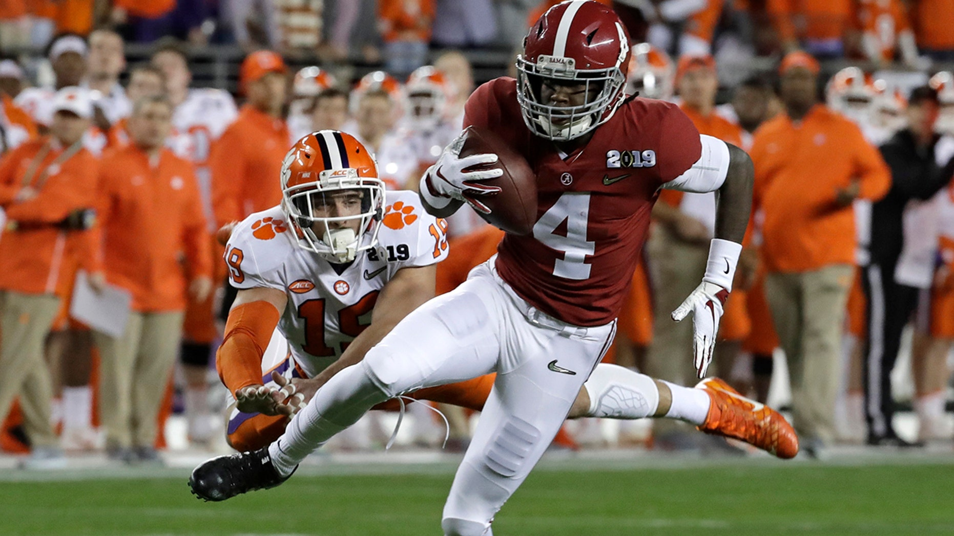 FILE - In this Jan. 7, 2019, file photo, Alabama's Jerry Jeudy catches a touchdown pass in front of Clemson's Tanner Muse during the first half the NCAA college football playoff championship game in Santa Clara, Calif.  (AP Photo/Chris Carlson, File)