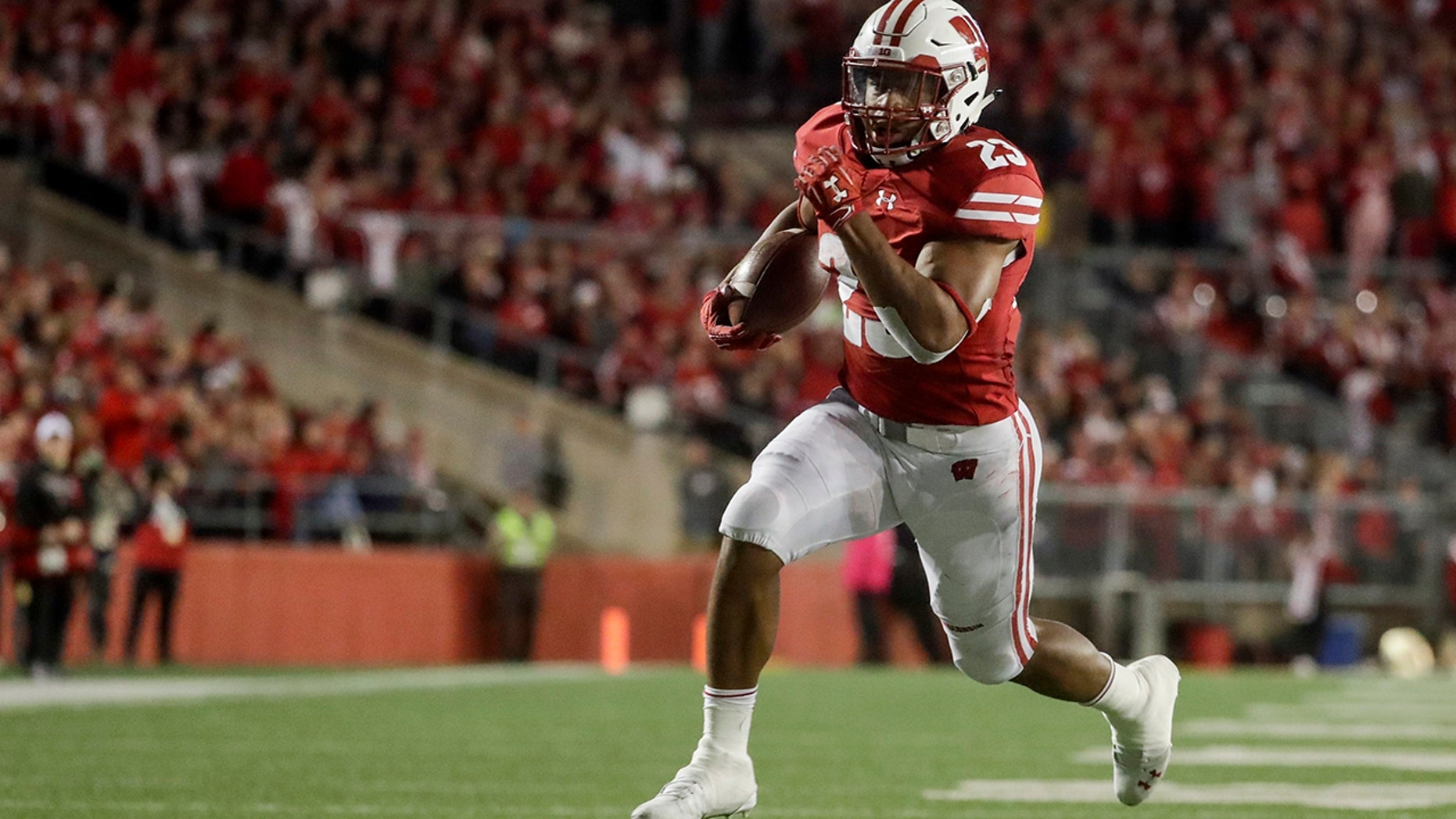 FILE - In this Oct. 6, 2018, file photo, Wisconsin's Jonathan Taylor runs for a touchdown during the second half of an NCAA college football game against Nebraska, in Madison, Wis. College football's race for its top individual awards this season will have a couple of standout players seeking repeats. Wisconsin's Jonathan Taylor won the Doak Walker Award as the nation's top running back last season, while Alabama's Jerry Jeudy earned the Fred Biletnikoff Award as college football's most outstanding receiver. Both players are back for their junior seasons. (AP Photo/Morry Gash, File)