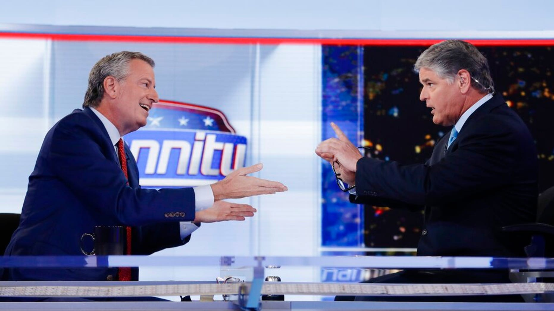 "Fox News host Sean Hannity, right, interviews Democratic presidential candidate and New York Mayor Bill de Blasio during a taping of his show, ""Hannity."" (AP Photo/Frank Franklin II)"
