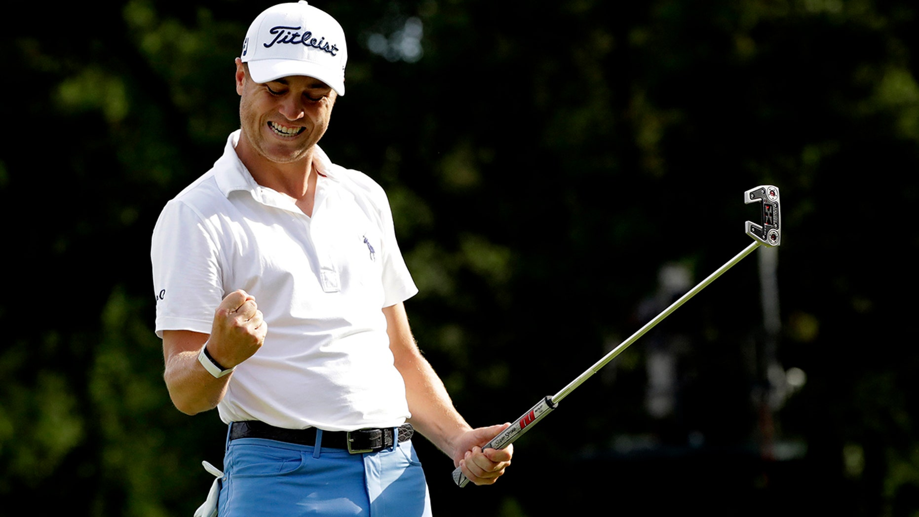 Justin Thomas celebrates after making a birdie on the 18th green during the final round at the BMW Championship golf tournament at Medinah Country Club, Sunday, Aug. 18, 2019, in Medinah, Ill. (AP Photo/Nam Y. Huh)