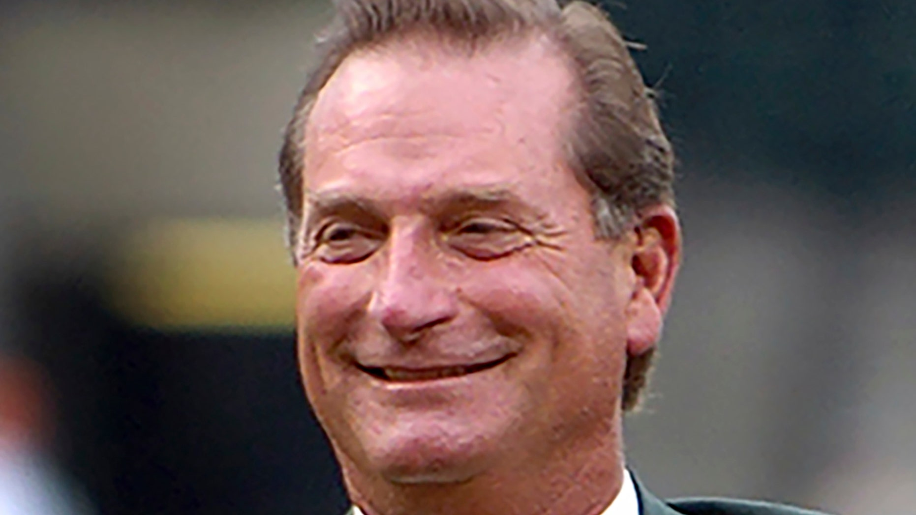 FILE - In this Aug. 26, 2006, file photo, former Baltimore Orioles baseball player Doug DeCinces smiles after being inducted into the Orioles Hall of Fame during a ceremony in Baltimore. DeCinces has been sentenced to eight months of home detention and ordered to pay a $10,000 fine for his role in an insider-trading scheme. (AP Photo/Gail Burton, File)