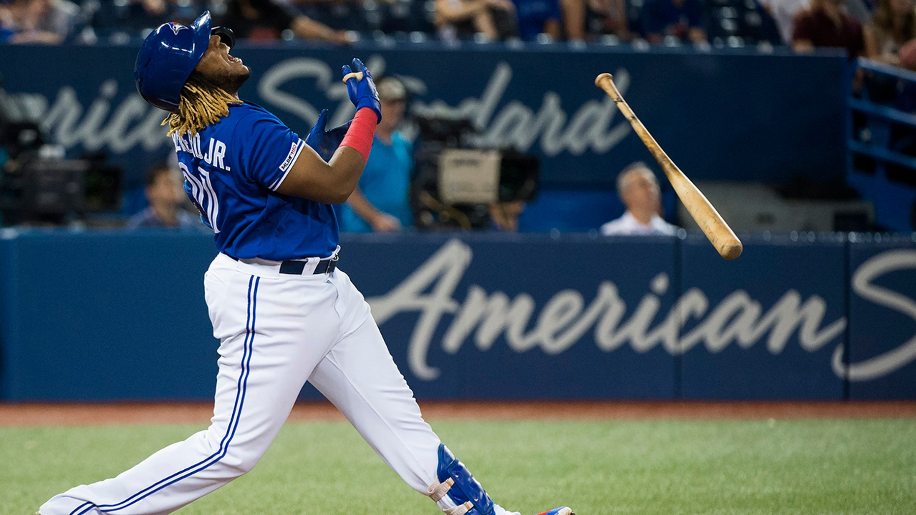 Toronto Blue Jays designated hitter Vladimir Guerrero Jr. reacts after hitting a pop flyout during ninth-inning baseball game action against the Tampa Bay Rays in Toronto, Sunday, July 28, 2019. (Nathan Denette/The Canadian Press via AP)