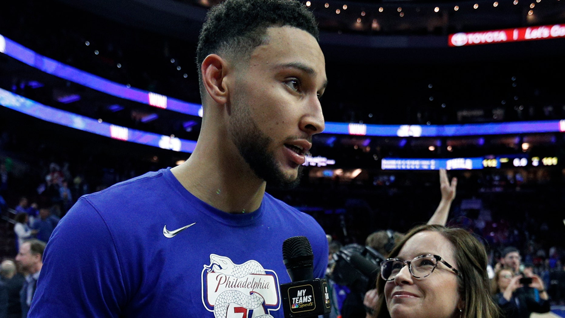 FILE - In this May 9, 2019, file photo, Philadelphia 76ers' Ben Simmons interviewed by 76ers sideline reporter Serena Winters following the second half of Game 6 of a second-round NBA basketball playoff series against the Toronto Raptors, in Philadelphia. (AP Photo/Chris Szagola, File)