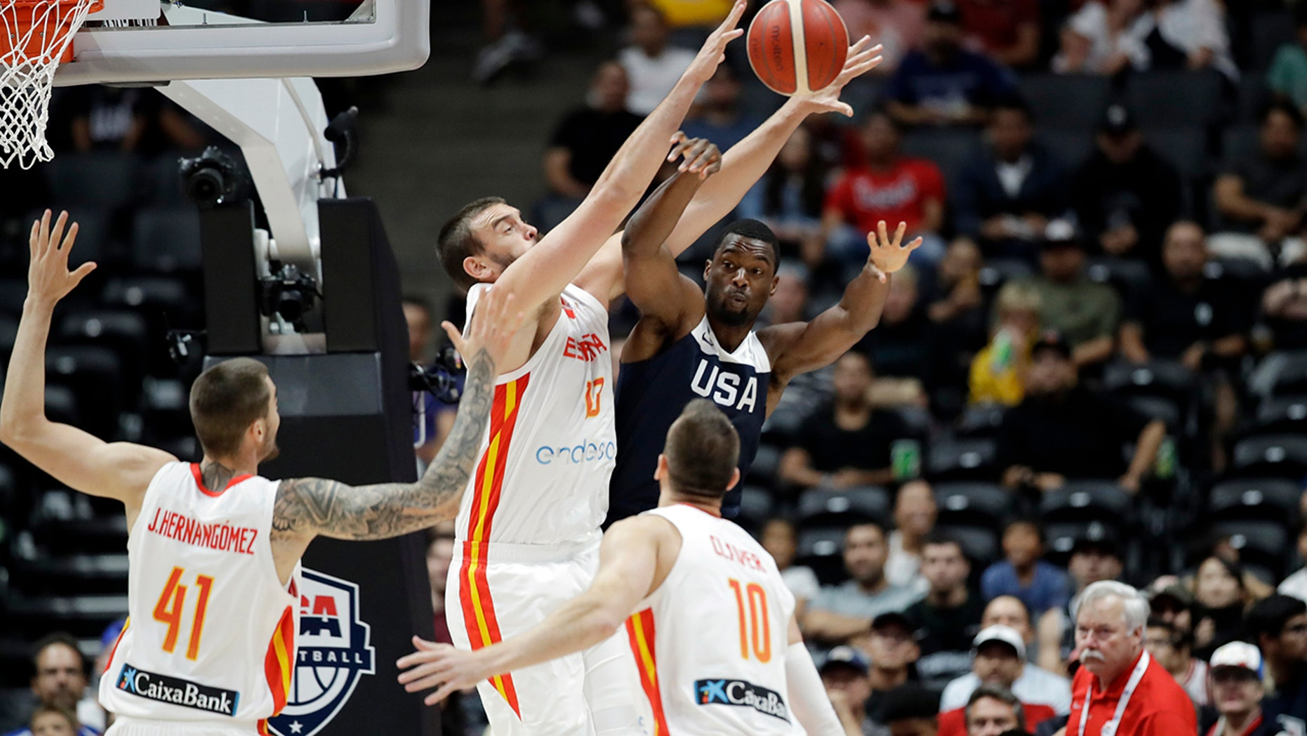United States' Harrison Barnes, center right, is defended by Spain's Marc Gasol, center left, during the first half of an exhibition basketball game Friday, Aug. 16, 2019, in Anaheim, Calif. (AP Photo/Marcio Jose Sanchez)