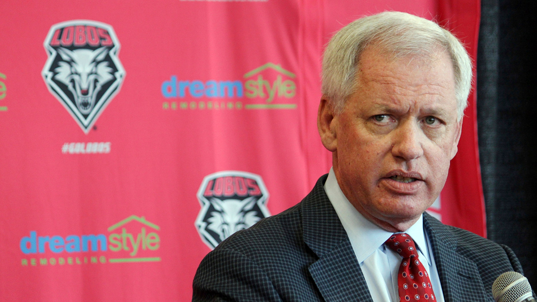 FILE - In this May 3, 2017, file photo, then-University of New Mexico athletics director Paul Krebs answers questions during a news conference in Albuquerque, N.M. Documents filed Wednesday, Aug. 21, 2019, in state district court show that a grand jury indicted the Krebs, 63, on embezzlement, larceny, and tampering charges in connection with an investigation into questionable spending by the school's troubled athletics department. (AP Photo/Susan Montoya Bryan, File)