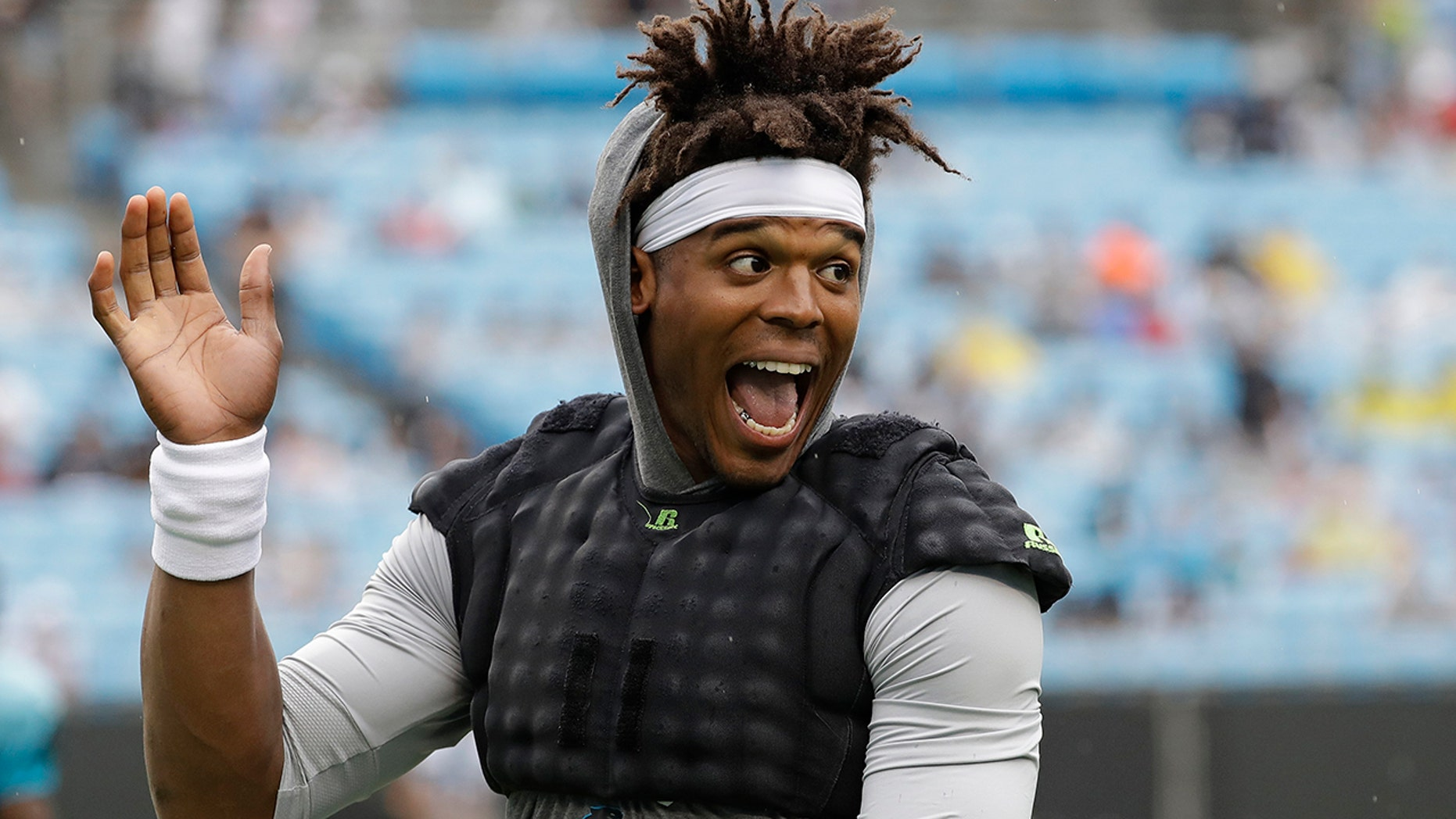 Carolina Panthers quarterback Cam Newtonwaves to the crowd during a Fan Fest practice at the NFL football team's training camp in Charlotte, N.C., Friday, Aug. 2, 2019. (AP Photo/Chuck Burton)