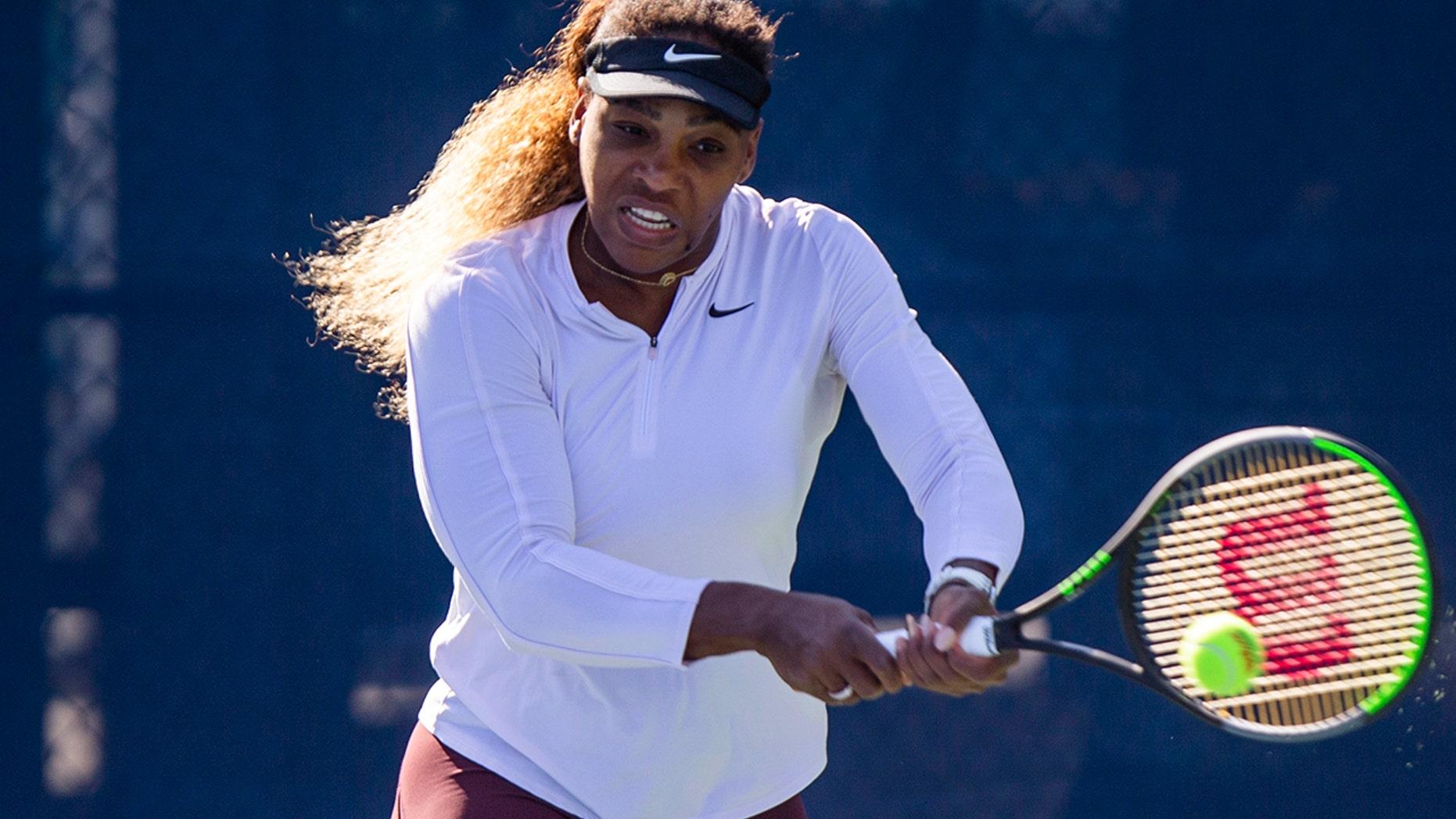 Serena Williams, of the United States, returns the ball as she practices for the U.S. Open tennis tournament Saturday, Aug. 24, 2019, in New York. (AP Photo/Eduardo Munoz Alvarez)