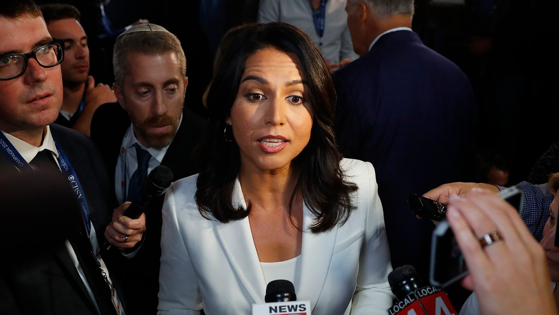 Rep. Tulsi Gabbard, D-Hawaii, answers questions after the second of two Democratic presidential primary debates hosted by CNN Thursday, Aug. 1, 2019, in the Fox Theatre in Detroit. (AP Photo/Paul Sancya)