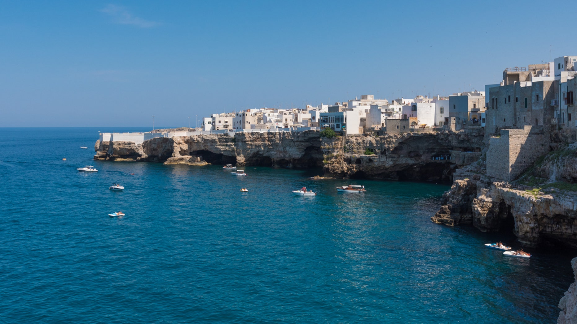 The famous sea town in province of Bari, southern Italy. The village rises on rocky spur over the Adriatic Sea, and is known tourist attraction.