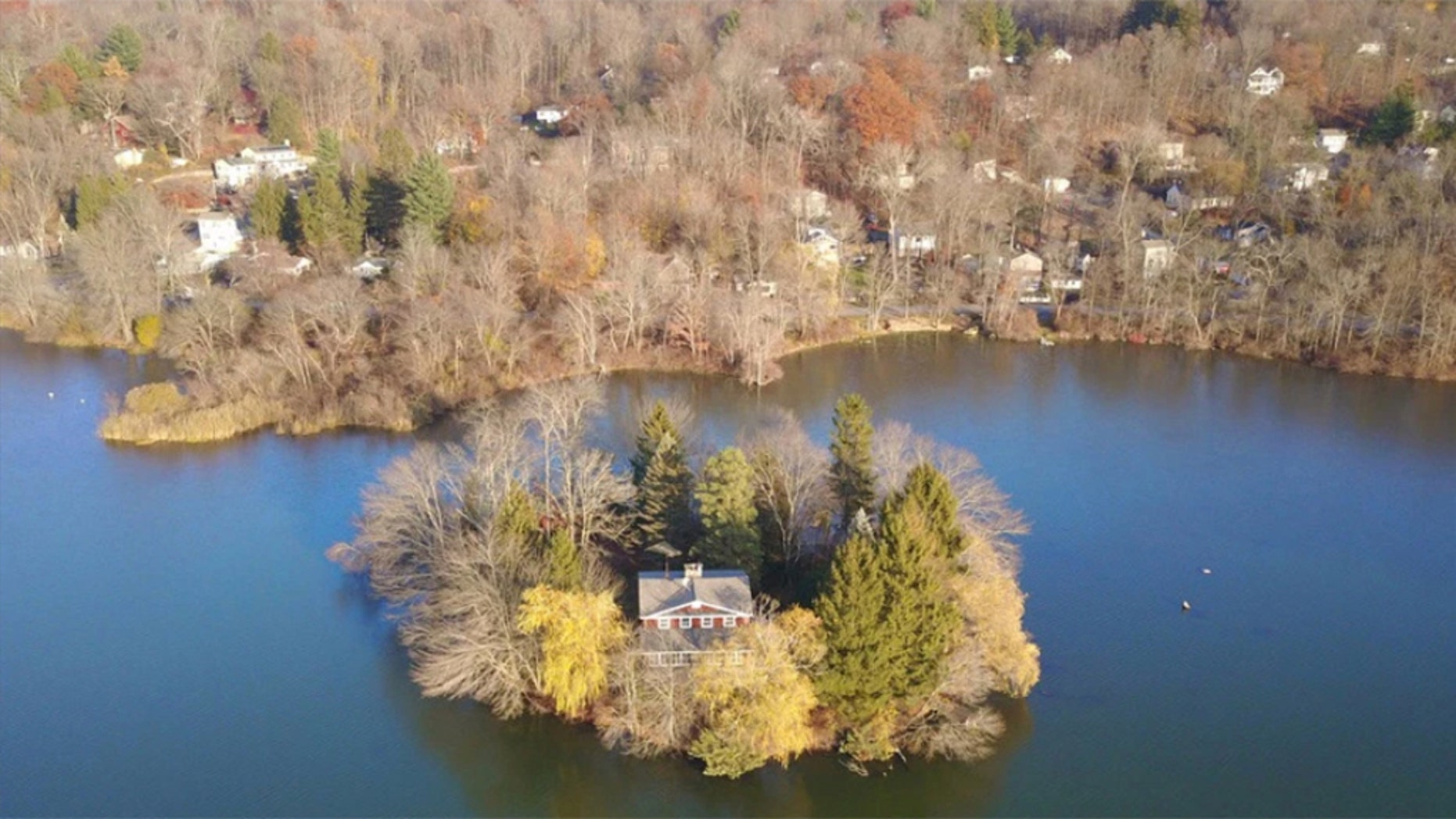 Just 60 miles north of Manhattan, a small island with a wee house has hit the market.
