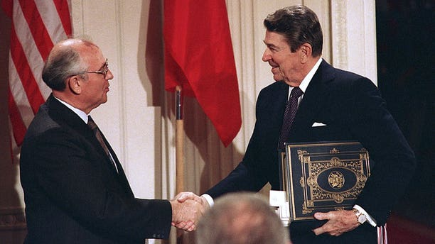 In this Dec. 8, 1987, file photo, President Ronald Reagan, right, shakes hands with Soviet leader Mikhail Gorbachev after the two leaders signed the Intermediate Range Nuclear Forces Treaty to eliminate intermediate-range missiles during a ceremony in the White House East Room in Washington. The landmark arms control treaty that Reagan and Gorbachev signed three decades ago is dead.