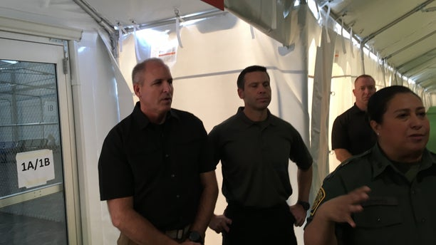 Touring a new migrant holding facility at the Tornillo Port of Entry in Texas are, from left, Mark Morgan, acting commissioner of U.S. Customs and Border Protection, and Kevin McAleenan, acting secretary of Homeland Security. (Charlie Lapastora/Fox News)