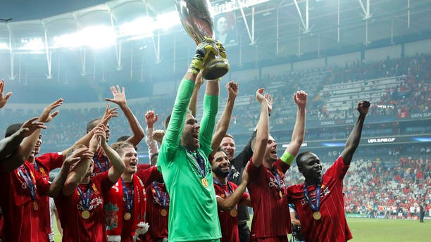 Liverpool's goalkeeper Adrian lifts up the trophy as he celebrates with players after winning the UEFA Super Cup soccer match between Liverpool and Chelsea, in Besiktas Park.