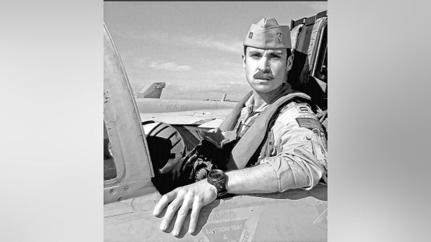 This undated photo provided Friday by the U.S. Navy shows Lt. Charles Z. Walker, 33, the pilot killed in the crash of a fighter jet in the California desert. (U.S. Navy via AP)