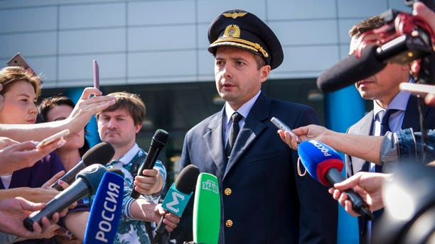 Damir Yusupov, 41-year-old Russian pilot, speaks to the media in Yekaterinburg, Russia, Friday, Aug. 16, 2019.