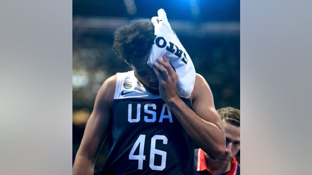 United States Derrick White walks off the court with a head injury during their exhibition basketball game against Australia in Melbourne, Saturday, Aug. 24, 2019. (AP Photo/Andy Brownbill)