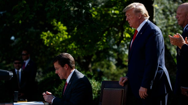 President Trump watching as Defense Secretary Mark Esper signed a document announcing the establishment of the U.S. Space Command. (AP Photo/Evan Vucci)