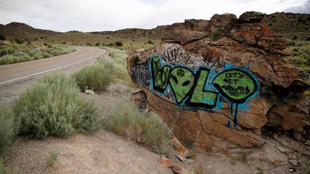 Alien-themed graffiti adorns a rock along the Extraterrestrial Highway, near Rachel, Nev.