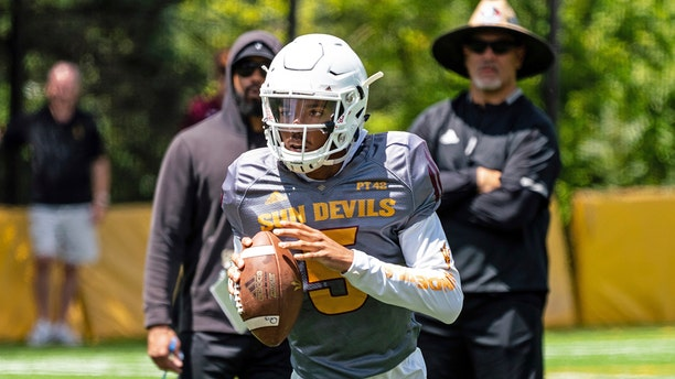 This Aug. 8, 2019, photo provided by Sun Devil Athletics shows Arizona State University freshman quarterback Jayden Daniels at practice in Payson, Ariz. Daniels will become the first Arizona State true freshman quarterback to start a season opener for the Sun Devils, as he won a four-man competition for the job. (Radmen Niven/Sun Devil Athletics via AP)