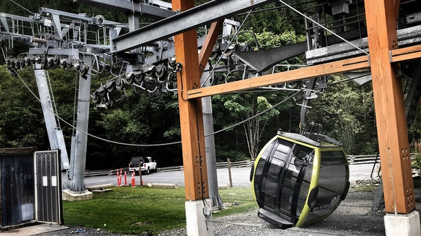 A gondola car can be seen on the ground after someone apparently cut a cable at the Sea to Sky Gondola in British Columbia early Saturday, according to police.