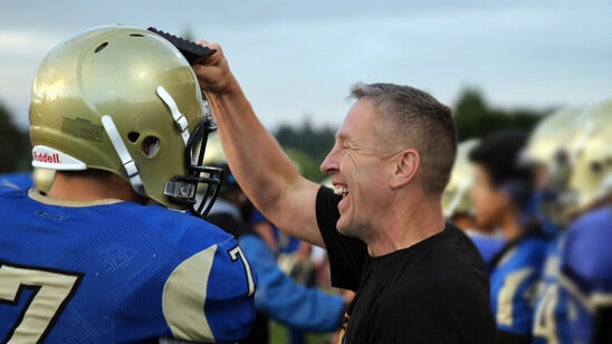 Coach Joe Kennedy encouraging his team.