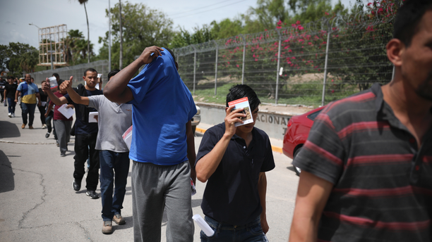 Migrants return to Mexico using the Puerta Mexico bridge that crosses the Rio Grande river in Matamoros, Mexico, July 31, 2019, on the border with Brownsville, Texas. (AP Photo/Emilio Espejel)