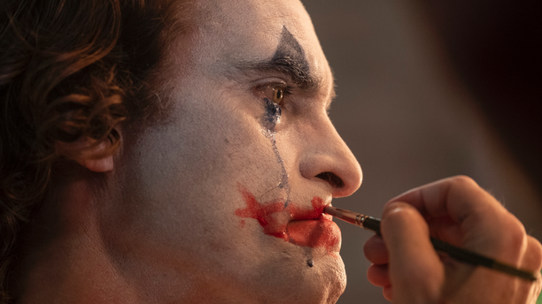 "This image released by Warner Bros. Pictures shows Joaquin Phoenix in a scene from ""Joker"""