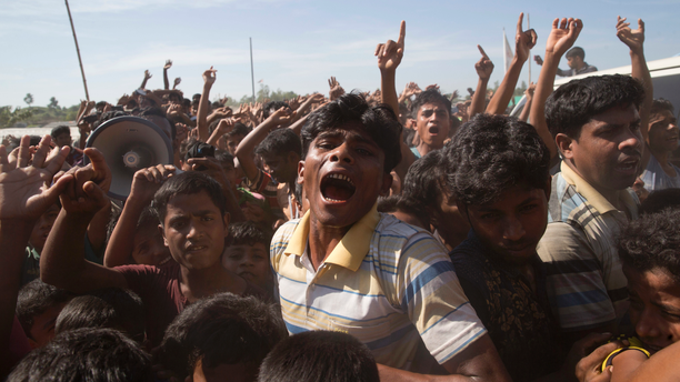 In this file photo dated Thursday, Nov. 15, 2018, Rohingya refugees shout slogans during a protest against the repatriation process at Unchiprang refugee camp near Cox's Bazar, in Bangladesh.