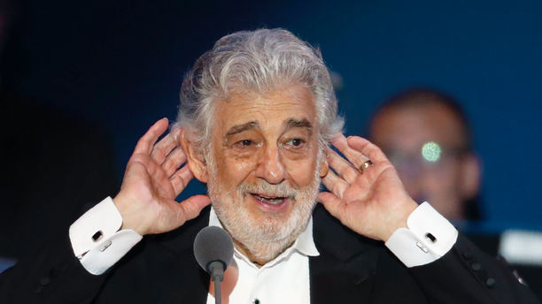 Placido Domingo listens to applause at the end of a concert in Szeged, Hungary, Wednesday, Aug. 28, 2019.
