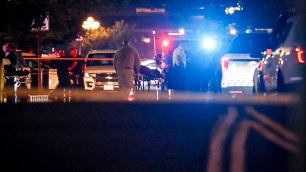 Bodies are removed from at the scene of a mass shooting, Sunday, Aug. 4, 2019, in Dayton, Ohio.