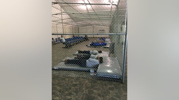 Migrants rest in the new migrant holding facility at the Tornillo Port of Entry in Texas. (Charlie Lapastora/Fox News)