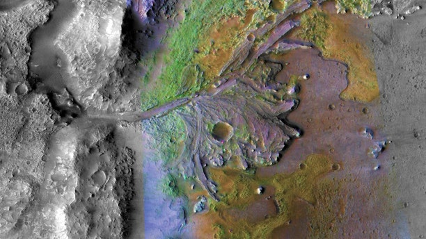 This is the site of the Mars 2020 landing. Chemical Alteration by Water, Jezero Crater Delta: On ancient Mars, water-carved channels and transported sediments to form fans and deltas within lake basins (color enhanced to show mineral types). (Credit: NASA/JPL-Caltech/MSSS/JHU-APL)