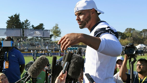 Dak Prescott pretends he can't hear the question when the subject turns to a new contract for the star quarterback of the Dallas Cowboys, while receiver Amari Cooper steadfastly says he simply doesn't think about what might be happening in his negotiations. Both reported to training camp on time as they prepare for the final year of their respective deals. (AP Photo/Michael Owen Baker, File)