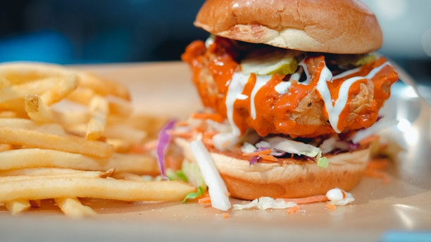 The Nashville Hot Chicken sandwich comes withhot sauce and Fresno Chile peppers. It is then topped with Napa slaw, pickles and ranch dressing.
