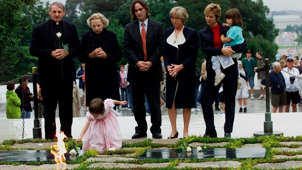Robert F. Kennedy's granddaughter Saoirse Kennedy Hill places a white rose at the Eternal Flame, President John F. Kennedy's gravesite, at Arlington National Cemetery in Arlington, Va., June 6, 2000. Hill died Thursday at age 22. (Associated Press)