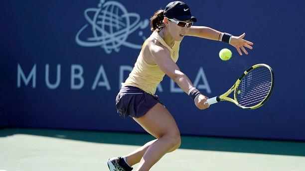 Zheng Saisai, of China, returns the ball to Aryna Sabalenka, of Belarus, during the finals of the Mubadala Silicon Valley Classic tennis tournament in San Jose, Calif., Sunday, Aug. 4, 2019. (AP Photo/Tony Avelar)