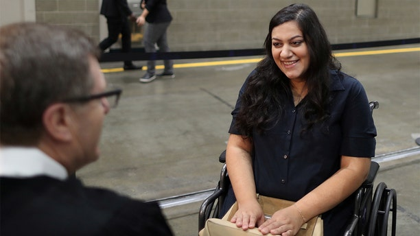 Tatev, who has lived in the U.S. for 17 years, went into labor before her U.S. citizenship ceremony and refused to go to hospital until she was sworn in as a U.S. citizen on Aug. 22, 2019. (REUTERS/Lucy Nicholson)