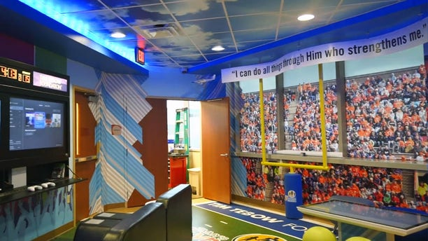 """The Tim Tebow Foundation's newest """"Timmy's Playroom"""" location at AdventHealth Daytona Beach has his favorite Bible verse and many opportunities for children in the hospital to play games and have fun."""