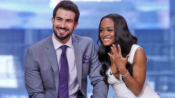 """""""The Bachelorette"""" star Rachel Lindsay and fiance Bryan Abasolo pose on """"Good Morning America"""" in August 2017. They tied the knot in late August 2019."""
