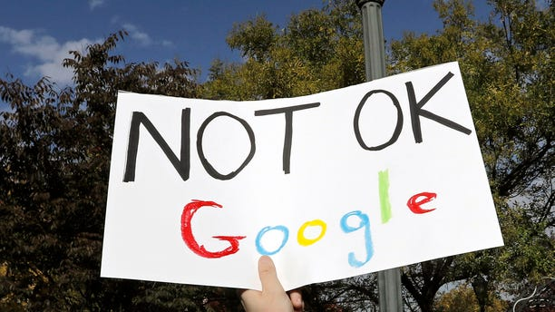 A Google employee holds a sign during a walkout to protest a range of issues at Jackson Square Park in New York, U.S., Thursday, Nov. 1, 2018.