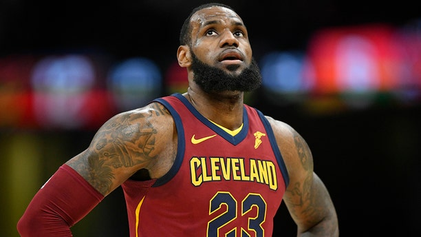 Apr 11, 2018; Cleveland, OH, USA; Cleveland Cavaliers forward LeBron James (23) reacts in the first quarter against the New York Knicks at Quicken Loans Arena. Mandatory Credit: David Richard-USA TODAY Sports - 10781577