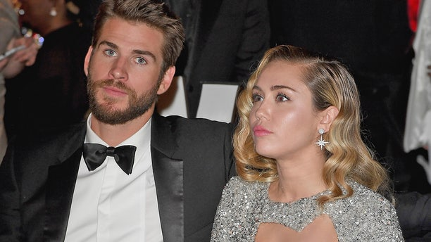 Liam Hemsworth, pictured here with Miley Cyrus in March 2018, spoke out on their separation. The pair married in December 2018 after a decade of on-again-off-again romance.