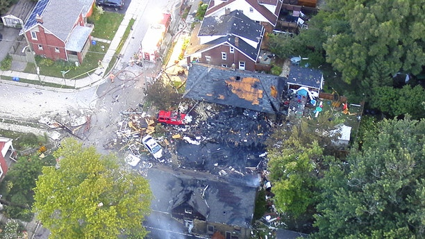 Photo shows devastation after a crash, explosion and fire Wednesday night in London, Ontario.